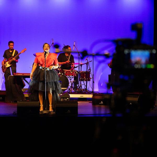 Black Music Month Celebration, performer honoring Aretha Franklin on stage