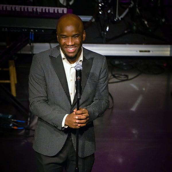 Black Music Month Celebration, host on stage