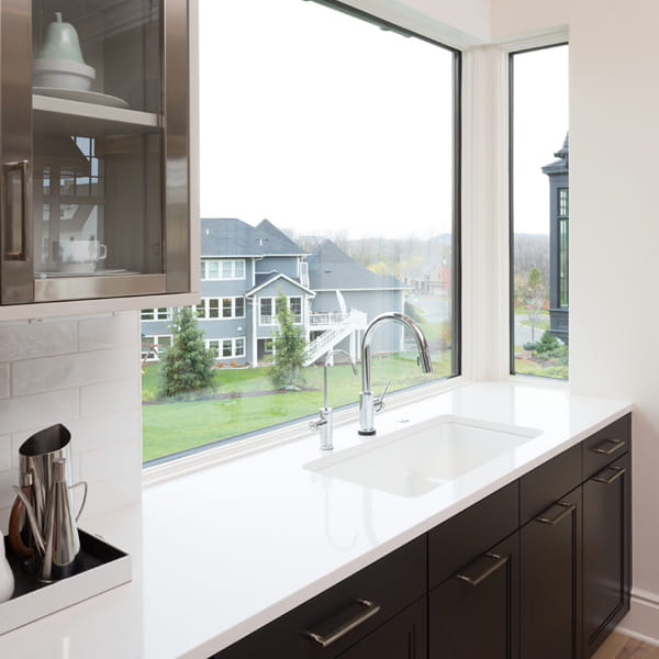 Kitchen with Andersen 400 Series Picture windows with black and white painted window frames