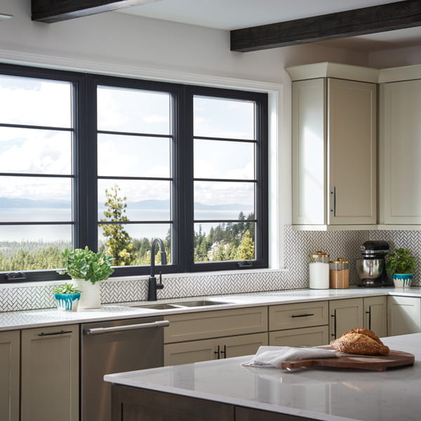 Kitchen with black interiors and hardware with 100 series casement Andersen Windows